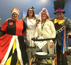 Four sqm staff dressed up for Halloween as Alice in Wonderland